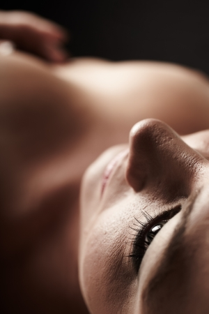 Nude Young adult caucasian woman lying on her back  Shallow Depth of Field  Focus on her eye  Stock Photo - 13644652