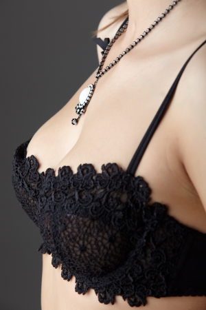 Young adult caucasian woman wearing black lace lingerie on a neutral grey background Stock Photo - 13644563