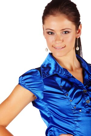 Young adult caucasian businesswoman with dark brunette hair and blue eyes wearing a fancy blue shirt with flawless skin and natural makeup on a white background  Stock Photo - 13872224