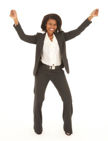 Young adult Caucasian businesswoman wearing a grey suit with curly brown hair on a white background Stock Photo - 13872123