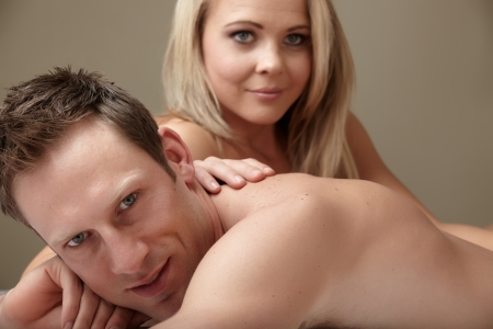 Young and fit caucasian adult couple lying on naked on a bed   Stock Photo - 13872209