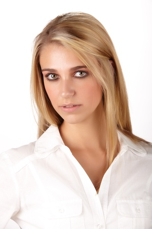 Young adult caucasian woman with long blonde hair and green eyes wearing a plain white shirt with flawless skin and natural makeup  Stock Photo - 14227648