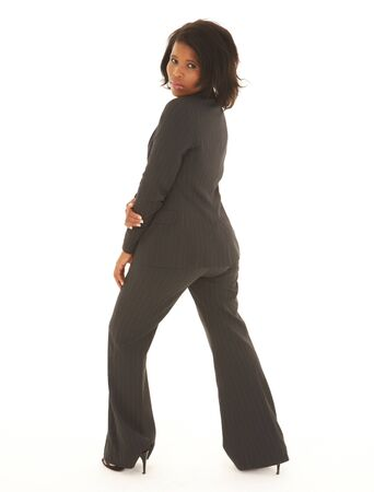 Young adult Caucasian businesswoman wearing a grey suit with curly brown hair on a white background  NOT ISOLATED Stock Photo - 14227633