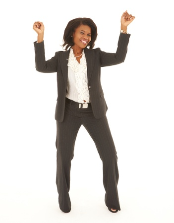 Young adult Caucasian businesswoman wearing a grey suit with curly brown hair on a white background  NOT ISOLATED Stock Photo - 14227641
