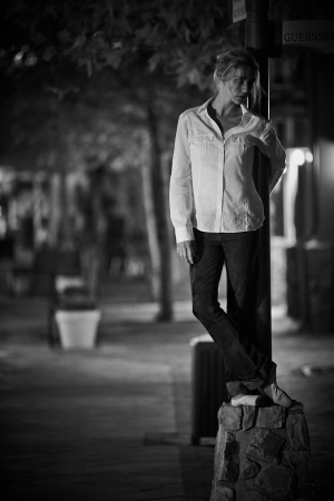 Young adult blonde ballerina dancing at night under signs and lamp posts in a general urban area Stock Photo - 17343246