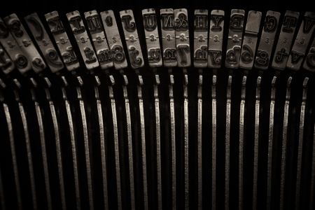 A Closeup image of the inverted keys or typebars of an old style typewriter in monotone Stock Photo - 17347096