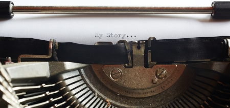 A Closeup image of the typebars and ribbon of an old style typewriter and paper with the text  My Story     Shallow Depth of Field  in a panorama crop Stock Photo - 17385442