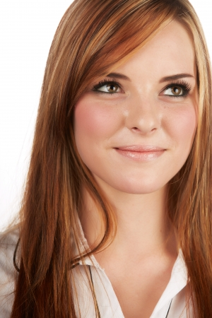 auburn: Beautiful young caucasian adult woman with long auburn red hair on a plain background, wearing a white button shirt  Stock Photo