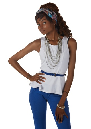 Young black african adult woman in a casual outfit of Blue pants and a white shirt with a hairpiece and jewelry isolated on a white background Stock Photo - 18394488