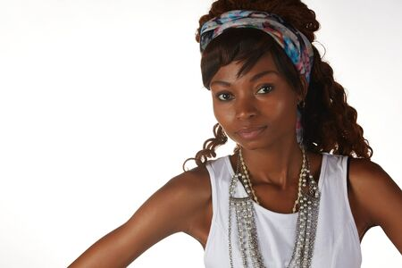 hairpiece: Young black african adult woman in a casual outfit and a white shirt with a hairpiece and jewelry isolated on a white background