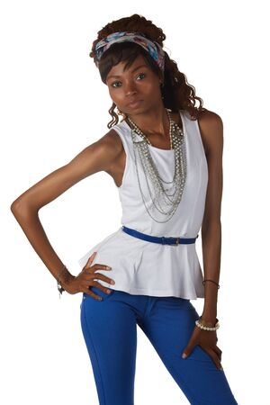 hairpiece: Young black african adult woman in a casual outfit of Blue pants and a white shirt with a hairpiece and jewelry isolated on a white background Stock Photo