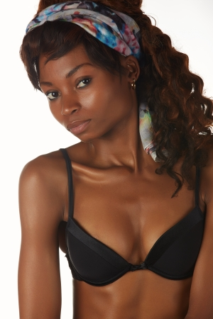 Beautiful young black african adult woman in black lingerie isolated on a white background Stock Photo - 18394551