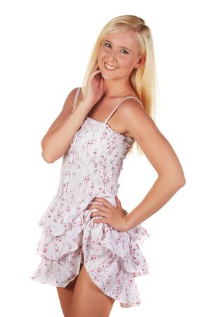 Beautiful and very sexy young adult caucasian woman in a casual short summer dress with blonde hair and blue eyes, isolated against a white background Stock Photo - 18394496
