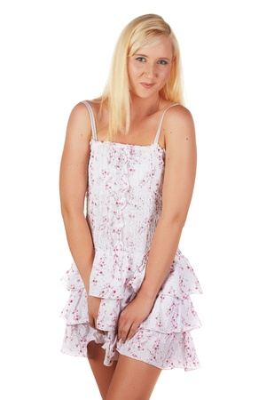 Beautiful and very sexy young adult caucasian woman in a casual short summer dress with blonde hair and blue eyes, isolated against a white background Stock Photo - 18394481