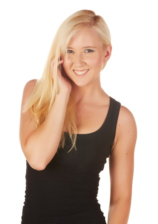 Beautiful and very sexy young adult caucasian woman in a casual black top with blonde hair and blue eyes, isolated against a white background Stock Photo - 18394491