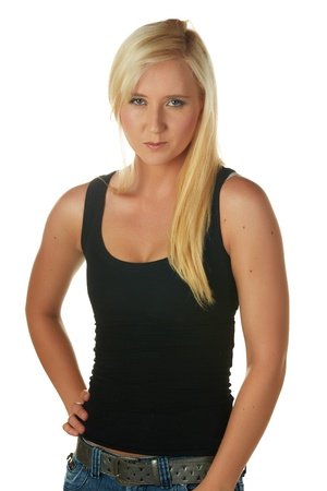 Beautiful and very sexy young adult caucasian woman in a casual black top with blonde hair and blue eyes, isolated against a white background Stock Photo - 18394509