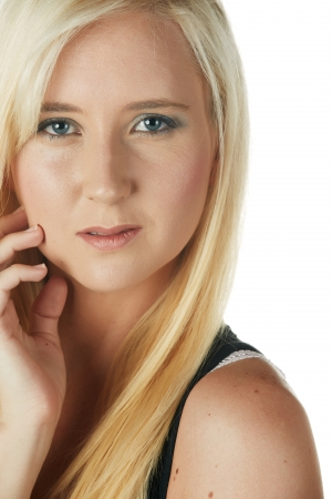 Beautiful and very sexy young adult caucasian woman in a casual black top with blonde hair and blue eyes, isolated against a white background Stock Photo - 18394543