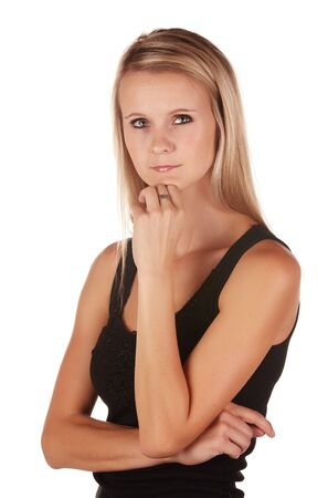 Beautiful and very sexy young adult caucasian woman in a casual black top with blonde hair and green eyes, isolated against a white background Stock Photo - 18394486