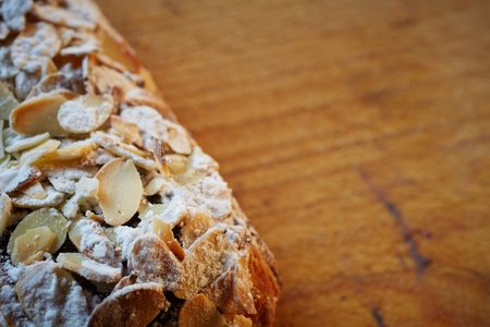 Fresh chocolate and Almond rollover croissant pastry, sprinkled with icing sugar on a brown wooden serving board with copy space  - Shallow Depth of Field  DOF Stock Photo - 18518181