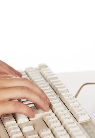 Beautiful and sexy young adult caucasian businesswoman with honey blonde hair wearing a casual business outfit working on a computer with her hands on a keyboard Stock Photo - 18706258