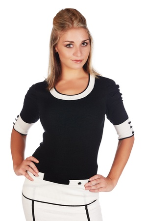 Beautiful and sexy young adult caucasian businesswoman with honey blonde hair wearing a casual white and black business outfit against a white background Stock Photo - 18659665