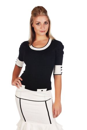 Beautiful and sexy young adult caucasian businesswoman with honey blonde hair wearing a casual white and black business outfit against a white background Stock Photo - 18659646