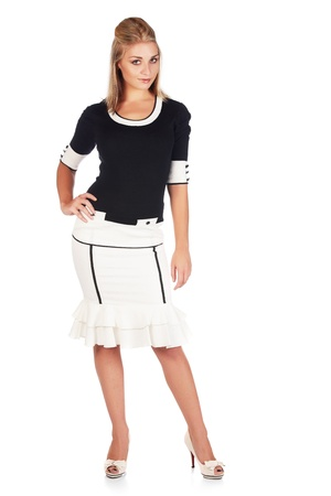 Beautiful and sexy young adult caucasian businesswoman with honey blonde hair wearing a casual white and black business outfit against a white background Stock Photo - 18659633