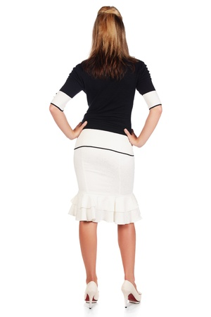 Beautiful and sexy young adult caucasian businesswoman with honey blonde hair wearing a casual white and black business outfit from behind, against a white background Stock Photo - 18659634