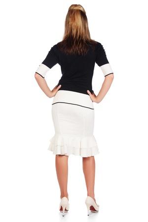culo di donna: Bella e Sexy giovani adulti caucasica imprenditrice con miele capelli biondi che indossa un casual bianco e nero vestito da dietro, contro uno sfondo bianco
