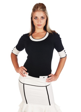 Beautiful and sexy young adult caucasian businesswoman with honey blonde hair wearing a casual white and black business outfit against a white background Stock Photo - 18659642