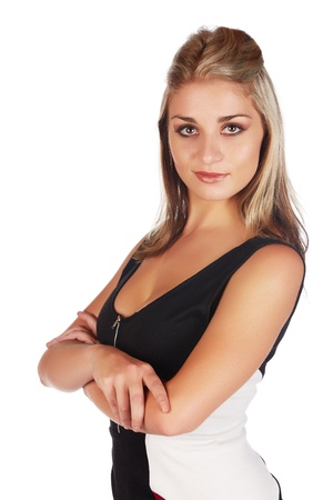 Beautiful and sexy young adult caucasian businesswoman with honey blonde hair wearing a casual white and black business outfit against a white background Stock Photo - 18659651