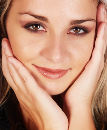 Portrait of a beautiful and sexy young adult caucasian businesswoman with honey blonde hair and brown eyes with natural make-up Stock Photo - 18659664