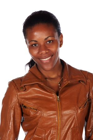 slicked back hair: Beautiful black african young adult woman casually dressed in a brown leather jacket and Blue jeans with white boots and with her hair slicked back into a ponytail and isolated on a white background