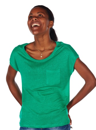 slicked back hair: Beautiful black african young adult woman casually dressed in an emerald green t-shirt with her hair slicked back into a ponytail and isolated on a white background