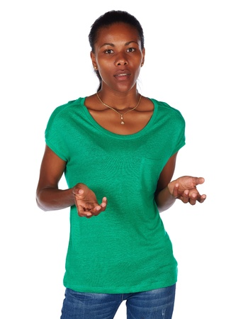 slicked: Beautiful black african young adult woman casually dressed in an emerald green t-shirt and Blue jeans and with her hair slicked back into a ponytail and isolated on a white background
