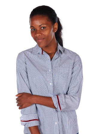 slicked back hair: Pretty black african young adult businesswoman casually dressed in a blue pinstripe office shirt with her hair slicked back into a ponytail and isolated on a white background Stock Photo