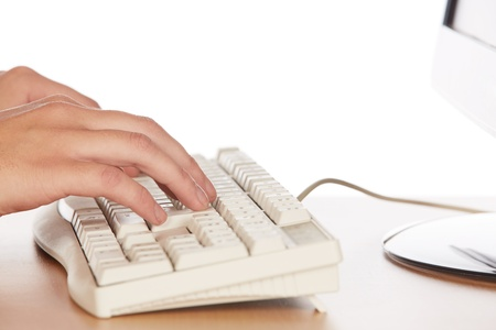 honey blonde: Beautiful and sexy young adult caucasian businesswoman with honey blonde hair wearing a casual business outfit working on a computer with her hands on a keyboard