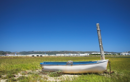 fishermens: Derelict fishermens boat next to the water - Knysna Harbour, South Africa