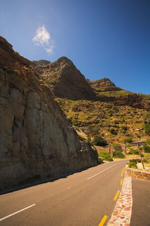 The dangerous winding road on Chapmans Peak, South Africa Stock Photo - 19373021