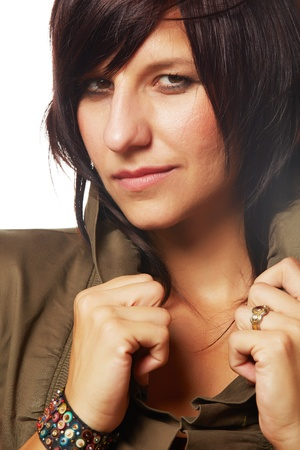 woman short hair: Beautiful and mature adult caucasian woman with red lips, dark hair and brown eyes wearing a short sleeve brown jacket  Stock Photo