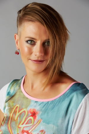 shaved head: Beautiful young adult blonde caucasian woman with an funky modern hair cut on a neutral background