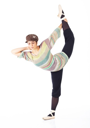 en pointe: Modern female ballet dancer with black pants and a colorful striped jersey and cap en pointe on a white background in various ballet positions