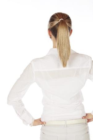 포니 테일 - 흰색 배경에 모든 흰색과 그녀의 머리를 입고 아름 다운 젊은 금발의 caucasian 여자
