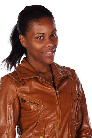 Beautiful black african young adult woman casually dressed in a brown leather jacket Stock Photo - 20334528