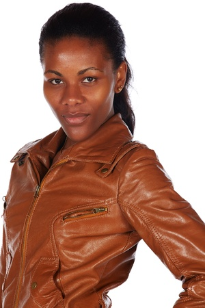 Beautiful black african young adult woman casually dressed in a brown leather jacket Stock Photo - 20334510