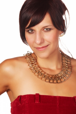 Beautiful and mature adult caucasian woman with red lips, dark hair and brown eyes wearing a open shoulder red top with a gold necklace Stock Photo - 20335267