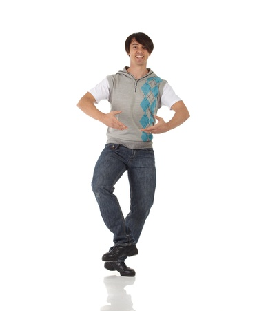 tap dance: Tap dancer in blue jeans and tap shoes doing steps on a white background and floor