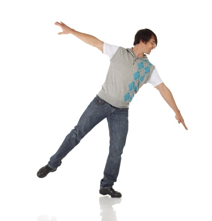 moves: Tap dancer in blue jeans and tap shoes doing steps on a white background and floor
