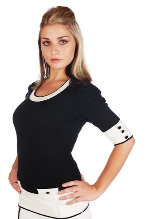 honey blonde: Beautiful and sexy young adult caucasian businesswoman with honey blonde hair wearing a casual white and black business outfit against a white background Stock Photo