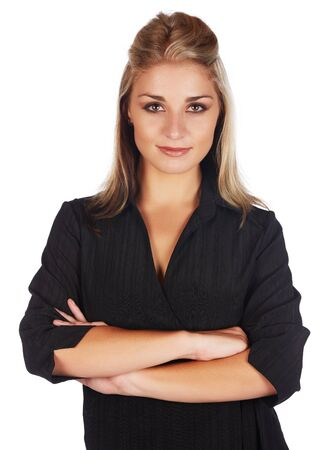 honey blonde: Beautiful and sexy young adult caucasian businesswoman with honey blonde hair wearing a casual black business outfit against a white background and with her arms crossed